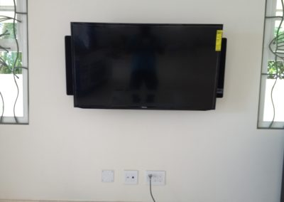 Television Mounted with speakers alongside.